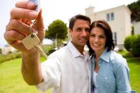 couple with keys to new home
